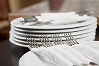 Forks and knives wrapped in paper napkins (thumbnail)