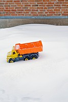 Toy Dumper truck in the snow