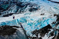 Guiding group throught blue ice. Beautiful landscape at Franz Josef Glacier. West Coast, South Island, New Zealand.