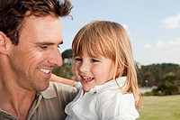 Spain, Mallorca, Palma, Father and daughter smiling, close up