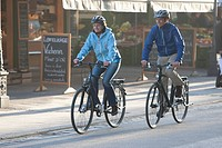 Germany, Bavaria, Munich, Man and woman riding bicycle