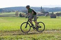 Germany, Bavaria, Mature man riding bicycle (thumbnail)