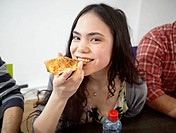 Germany, Cologne, Woman eating pizza