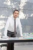 Germany, Leipzig, Businessman with architectural model, portrait (thumbnail)