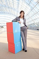 Germany, Leipzig, Businesswoman with cubes, portrait