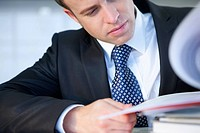 Close up of businessman reviewing report