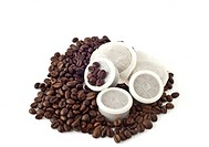 coffee pods and coffee beans on white background