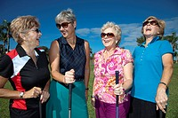 Senior Caucasian women playing golf