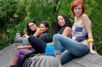 Women hanging out together on rooftop