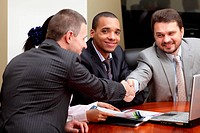 Multi ethnic business team at a meeting. Interacting. Focus on african_american man