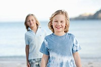 Spain, Mallorca, Children on beach, smiling, portrait