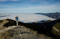 Germany, Bavaria, Walchesee Region, Hiker on mountain