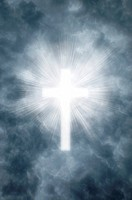 Heavenly rays shining through gray clouds in the shape of a Christian cross