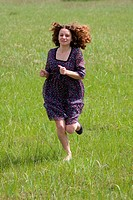 running girl on the green field