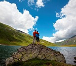 Couple on mountains lake