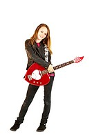 Teenage girl with a red heart_shaped electric guitar