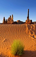 Sand dunes in front of Totem Pole and Yei Bi Chei rock formations after sunrise, Monument Valley, Navajo Tribal Park, Navajo National Reservation, Ari...