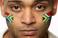Disappointed Young Male Sports Fan With South African Flag Painted On Face