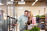 Family shopping together in supermarket (thumbnail)
