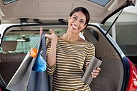 Woman unloading shopping from car