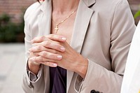Close up of woman&#8217;s hands folded in prayer