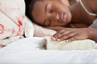 Girl asleep with Bible in bed