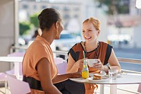 Businesswomen talking in cafe