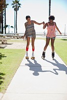 Women skating together outdoors