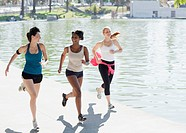 Women jogging together in park
