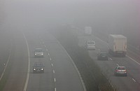 Autobahn A52, motorway, in thick fog, autumn, visibility under 100 metres, between Duesseldorf and Essen, North Rhine-Westphalia, Germany, Europe