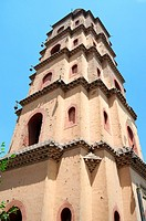 Bottom view of an ancient Chinese pagoda against blue sky