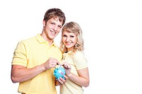 A young couple holding piggy banks, can be used for finance or saving concept