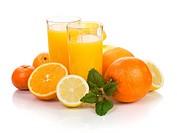 Citrus fruits and two glasses of fresh orange juice