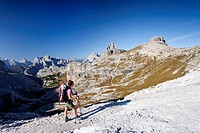 HIkers on Buellelejoch pass during the ascent to Mt Paternkofel above Zsigmondy hut, Mt Paternkofel, Three Peaks and the Cadini range at back, Hochpus...