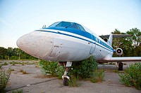 Old russian airplane YAK_40 is on the disused airfield