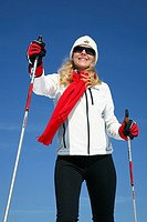 Young woman, about 25 years, against a blue sky, cross-country skiing, near Masserberg, Thuringian Forest mountains, Thuringia, Germany, Europe