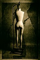 Female mannequin hanging from modeling stand, with birthmark background, multiple image lith print
