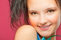 Portrait of a beautiful young woman on a red background