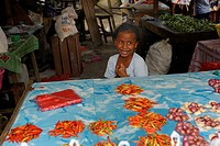 Little Papuan girl selling chili peppers and onions at the market, Kota Biak, Biak Island, Irian Jaya, Indonesia, Southeast Asia, Asia