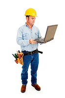 Full body view of a construction contractor working on his laptop. Full Body isolated on white.