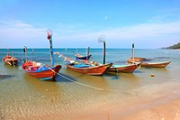 fisherman long tail boat park at the Rayong beach in Thailand