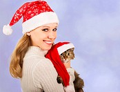 cute girl in a Christmas hat with cat