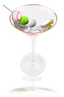 martini and olives made from a baseball,tennis ball and golf ball isolated on white background with a reflection and clipping path