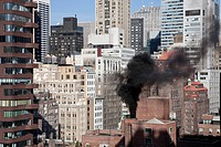 Smoke pollution blackens Manhattan skyline..Buring heavy fuel oil creates black acrid smoke. Buring unrefined sludgeno.6 fuel oil creates black acrid ...