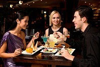 Man and women having dinner together