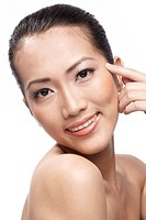 Fresh clear healthy skin on the face of beautiful Asian woman over white background