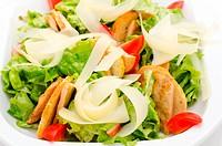 fresh Caesar salad with ham and tomatoes