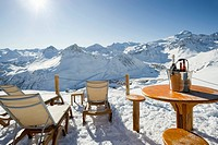 Deck chairs and tables, view of snow-covered mountains, Tignes, Val d'Isere, Savoie, Alps, France, Europe