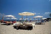 Sunbeds and sunshades on the beach of Santa Eulalia, Ibiza, Balearic Islands, Spain, Europe