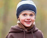 Young boy in warm clothing outdoor portrait.
